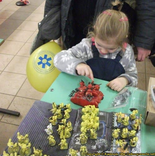 Small girl playing with space marines