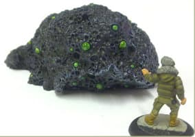 Size comparison of Colossal Shoggoth miniature with 1:56 (28mm / 32mm) scale figure from Fenris Games company. From left to right: Shoggoth Rising, APEX Agent Fuchs.