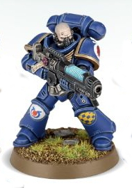Futuristic warrior in heavy armour in 1/64 scale (Primaris Space Marine Hellblaster Sergeant in Mk10 Tacticrmour in 1/64 scale (Primaris Space Marine Hellblaster Sergeant in Mk10 Tacticusus armour, with plasma incinerator from Dark Imperium set for Warhammer 40.000 Ed8) from Games Workshop, 2017