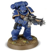 Futuristic warrior in full armour in 1/64 scale (Primaris Space Marine Intercessor #3 in Mk10 Tacticus armour, with Mk2 Cawl Pattern bolt rifle for Warhammer 40.000 Ed8) from Games Workshop, 2017