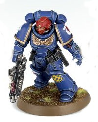 Futuristic warrior in full armour in 1/64 scale (Primaris Space Marine Intercessor Sergeant #1 in Mk10 Tacticus armour, with Mk2 Cawl Pattern bolt rifle for Warhammer 40.000 Ed8) from Games Workshop, 2017