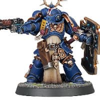 Futuristic warrior in full armour in 1/64 scale - Primaris Space Marine Lieutenant in Mk10 Tacticus armour with Iron Halo, with neo-volkite pistol and storm shield, carrying power sword from Indomitus set for Warhammer 40,000 Ed9 from Games Workshop, 2020 - Miniature figure review