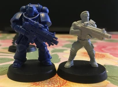 Size comparison of Bill miniature with 1:64 (28mm/32mm) scale Primaris Space Marine miniature for Warhammer 40,000 from Games Workshop. From left to right: Primaris Space Marine Intercessor #6 in Mk10 Tacticus armour, with Mk2 Cawl Pattern bolt rifle, Bill.