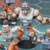 Futuristic humanoid warrior in 1/56 scale - Long Rock Lifers Grogan Keeper #1 for DreadBall from Mantic Games, 2014