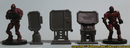 Size comparison of the Computer Terminal from the Star Saga: The Eiras Contract Core Set from Mantic Games with 1:56 (28mm / 32mm) scale Enforcers from Mantic Games. From left to right: Enforcer, Computer Terminal #3, Computer Terminal #2, Computer Terminal #1, Enforcer.