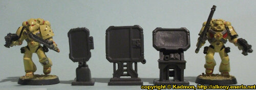 Size comparison of the Computer Terminal from the Star Saga: The Eiras Contract Core Set from Mantic Games with 1:64 (28mm/32mm) scale Space Marines from Games Workshop. From left to right: Space Marine, Computer Terminal #3, Computer Terminal #2, Computer Terminal #1, Space Marine.