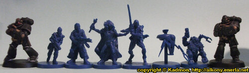 Size comparison of the mercenaries from Star Saga: The Eiras Contract Core Set from with 1:64 (28mm/32mm scale) scale Primaris Space Marines from Games Workshop. From left to right: Primaris Space Marine Hellblaster Sergeant #1, Captain Erika Dulinsky, Francesco 'The Devil' Silvaggio, Alyse, Wrath #2, Combat Utility Robot B07153 'Curby', Ogan Helkkare, Primaris Space Marine Hellblaster #2.