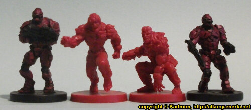 Size comparison of the Star Saga: The Eiras Contract Core Set Plague Victim miniature figures from Mantic Games with 1:56 (28mm / 32mm) Enforcers from Mantic Games. From left to right: Enforcer, Plague Victim #1, Plague Victim #2, Enforcer.