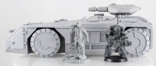 Size comparison of M577 Armoured Personnel Carrier from Prodos Games with miniature figures. From left to right: 1:50 (35mm) scale USCM Sergeant from Prodos Games, 1:64 scale WH40K Space Marine from Games Workshop.