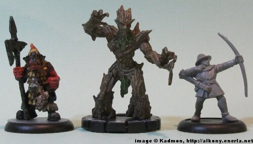 Oak Mage #047 for the Mage Knight from WizKids - 1:56 (28/32mm) comparison with Renegade Miniatures Orc with spear #2 (left) and Games Workshop Bretonnian Bowman #1 (right).